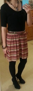 black shirt, tribal skirt