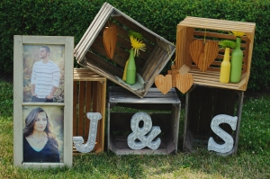 Engagement photos in old window frame, stacked crates, DIY wedding decor